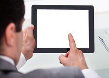 Businessman holding digital tablet Royalty Free Stock Images