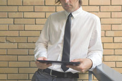Businessman holding digital tablet computer Royalty Free Stock Photos