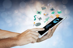 Businessman holding digital tablet,Different icons appearing Stock Photos