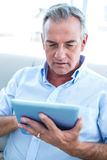 Businessman holding digital tablet Stock Photo