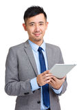 Businessman holding digital tablet Stock Images