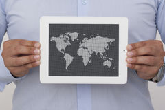 Businessman holding a digital tablet with map Royalty Free Stock Photos