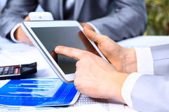 Businessman holding digital tablet Stock Image