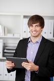 Businessman Holding Digital Tablet In Office Stock Photography