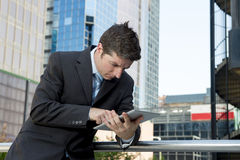 Businessman holding digital tablet outdoors working outdoors business district Royalty Free Stock Photography
