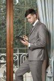 Businessman holding digital tablet Stock Photography