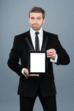 Businessman holding digital tablet pc with blank screen Royalty Free Stock Images