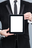 Businessman holding digital tablet pc with blank screen Stock Photo