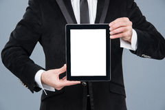 Businessman holding digital tablet pc with blank screen Royalty Free Stock Photos
