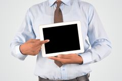 Businessman holding digital tablet pc Royalty Free Stock Image