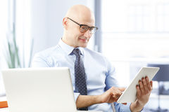 Businessman holding digital tablet Royalty Free Stock Images