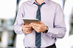 Businessman holding a  digital tablet Stock Images