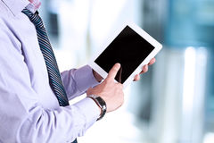Businessman holding a  digital tablet Royalty Free Stock Photo