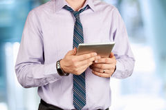 Businessman holding a  digital tablet Royalty Free Stock Image