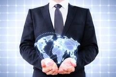 Businessman holding digital world map. On blue background Royalty Free Stock Photo