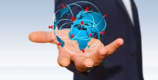 Businessman holding digital world map in his hands Royalty Free Stock Images