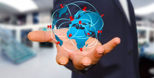 Businessman holding digital world map in his hands Royalty Free Stock Photography