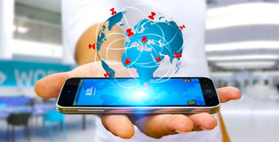 Businessman holding digital world map in his hands. Businessman with digital world map and pins floating over his mobile phone Stock Photography