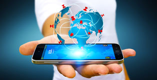 Businessman holding digital world map in his hands Stock Images