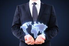 Businessman holding digital world map Royalty Free Stock Photography