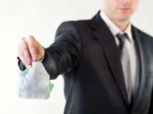 Businessman holding a dirty diaper Royalty Free Stock Photo