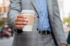 Businessman holding disposable cup Stock Photography