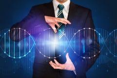 Businessman holding DNA Stock Image