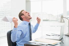 Businessman holding document cheering Stock Photography