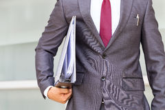 Businessman is holding document folder Stock Photo