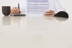 Businessman Holding Document And Pen Royalty Free Stock Images