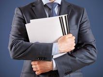 Businessman holding documents Royalty Free Stock Photo