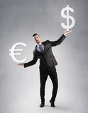 Businessman holding a dollar and euro symbol Royalty Free Stock Photography