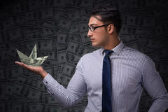 The businessman holding dollar paper boats Royalty Free Stock Photo