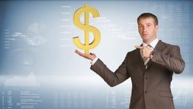 Businessman holding dollar sign. Blue gradient Stock Images