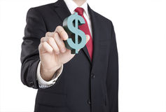 Businessman holding dollar sign Royalty Free Stock Photos