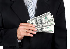 Businessman holding dollars Stock Photo