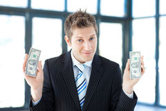 Businessman holding dollars Stock Images
