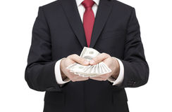 Businessman holding dollars Royalty Free Stock Photos