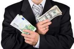 Businessman holding dollars and euros Royalty Free Stock Photos