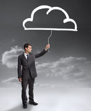 Businessman holding a drawing of a cloud Stock Photography