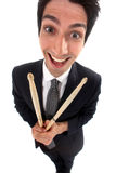 Businessman holding drum sticks Stock Images