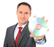 Businessman holding dvd Stock Photos