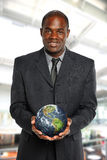 Businessman holding the earth Stock Image