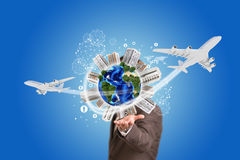 Businessman holding earth with buildings Stock Photo
