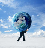 Businessman holding earth Stock Images