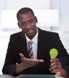 Businessman Holding Ecological Bulb Stock Image