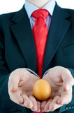 Businessman holding egg in hands Stock Images