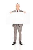 Businessman holding empty banner Royalty Free Stock Images
