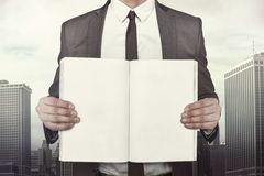 Businessman holding empty book front of him Royalty Free Stock Photography