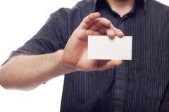Businessman holding empty business blank Stock Photo